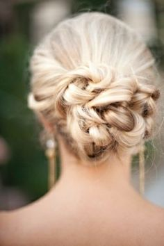 Creative, structured curly bun- I'd need some pretty kick ass earrings