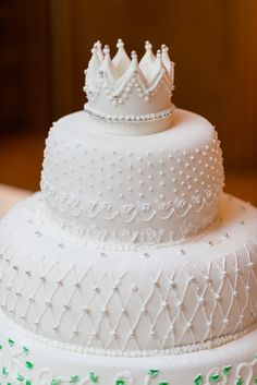 crown topper wedding cake fit for a princess, a beautiful princess from portugal. http://www.weddingchicks.com/2013/11/21/fantasy-wedding/
