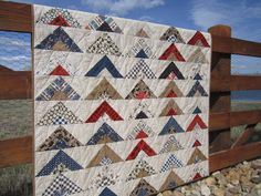 This cabin themed quilt is such a great quilt to display in your home. There is a southwest mountain cabin look to this quilt. This quilt reminds me of tents in the foreground with the quilting depict