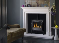Lincoln & Bloomsbury Multi-Fuel SE Stove Suite Lincoln 58'' or 54'' - Limestone* The Defra Approved Bloomsbury Multi-Fuel Stove Black(pictured), Gunmetal or Ivory 5kW Black Granite or Limestone Hearth 56'' x 18'' BxL Upgrade to Bloomsbury Mutli-Fuel SE 8kW £150 Upgrade to Gas Including Remote Control £499 Add Flue Pipe 1 Metre from £72 *Upgrade to Carrara Marble - £150 *Upgrade to Imperial Marble - £199 Multi-Fuel SE Package: £2999 saving from: £381