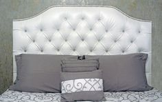 White faux leather tufted headboard with diamond buttons by St. Thomas & Co.