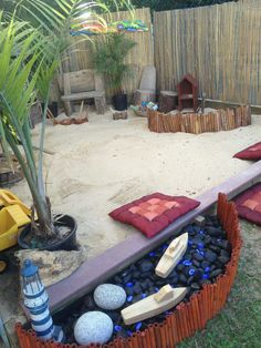 Inspiring Sandpit. Like the natural elements: plants, wood screening, pebbles