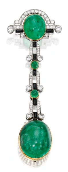 An Art Deco Platinum, 18 Karat Gold, Emerald, Diamond, Onyx and Enamel Lapel-Watch, VERGER Frères, France. Set with an oval-shaped cabochon emerald suspended from a second oval-shaped cabochon emerald with two conical cabochon emerald accents, set with old European and single-cut diamonds, with eight cabochon onyx tablets, the dial framed within a modified Greek key motif applied with black enamel, with French assay marks and maker's marks for Verger Frères, circa 1925.