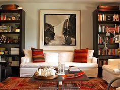 sofa between bookshelves