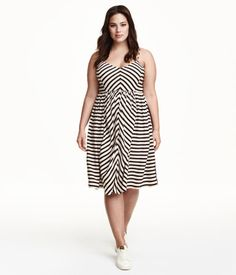 Striped V-neck dress in woven fabric with a slight sheen. Narrow, double shoulder straps, seam at waist, and smocking at back. Lined bodice.