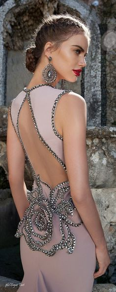 Backless dresses are not my favorite but this one still looks elegent. Gorgeous dress