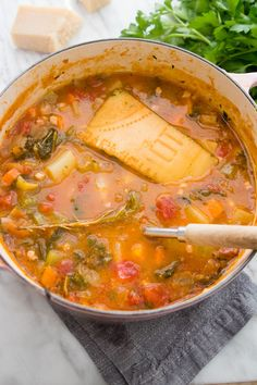 Tomato Recipes Winter Minestrone - Giadzy - Giada De Laurentiis - The ultimate comforting soup for the cold season. Don't skip the parmesan rind - it gives the soup tons of flavor! Giada Recipes, Soup Recipes, Cooking Recipes, Parmesan Rind, Stewed Potatoes, Russet Potatoes, Cheese Potatoes, Giada De Laurentiis, Pasta