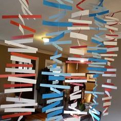 Colorful Paper Mobiles | FaveCrafts.com neat simple way to decorate looks abstract and awesome.