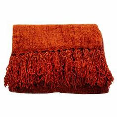 "Perfect draped over the sofa or at the foot of your bed, this cozily textured throw features a rich pomegranate hue and fringed trim.   Product: ThrowConstruction Material: ChenilleColor: PomegranateFeatures: Hand-knotted fringeDimensions: 50"" x 70""Cleaning and Care: Hand wash in cool water with woolite. Lay flat to dry. Do not bleach."