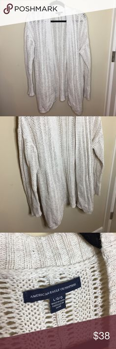 Long cream colored knit cardigan American Eagle long knit cream cardigan, has pockets as shown!! Long sleeve. Worn maybe 5 times!! Super cute with skinny jeans and boots!! American Eagle Outfitters Sweaters Cardigans
