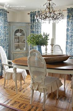 I like the color, the chair skirts, the floor covering (!) and the chandelier.