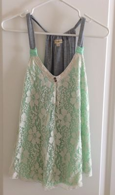 Front: light green fabric with a lace overlay. Back & straps: light gray. Size: M. New, without tags.