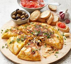 Make a classic Spanish omelette filled with pan-fried potatoes and onion. It makes a delicious light vegetarian meal or an easy tapas dish