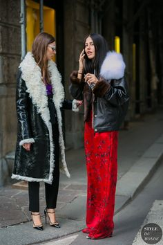 Vinyl & shearling coat on the left | Gilda Ambrosio and Giorgia Tordini by STYLEDUMONDE Street Style Fashion Photography