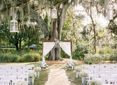 Rustic Outdoor Tampa Wedding Ceremony   Cross Creek Ranch Tampa Wedding Venue   Rustic Outdoor Tampa Weddings with White Draped Altar and White Folding Chairs