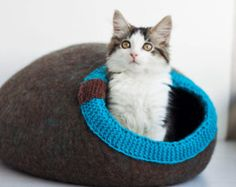 Pet bed - cat cave - cat house - dog bed - handmade wool cat bed - eco - brown Made to order.  Absolutely natural, from 100% organic not dyed , without any chemical treatment wool - special product for your pet. Cave hole decorated with hand knitted detail from wool (can be made in yours favorites colors).  It is no secret - pets likes boxes and hiding places, so your pet will enjoy and this covered wool bed. If you need and Linen inner pad, please, buy and this listing: https://www...
