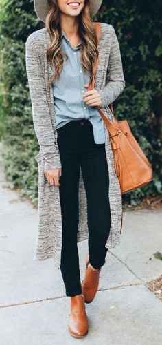 Chambray skirt, black pants, leather booties, leather bucket bag, grey duster sweater, and grey hat