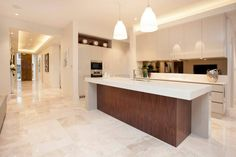 The walnut timber of the Domo kitchen is a stand out feature of the home...