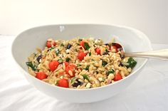 Greek Orzo Pasta Salad is light, orzo pasta studded with cherry tomatoes, chopped fresh spinach, kalamata olives, feta cheese, and red onion. It's dressed in balsamic dressing and garnished with toasted pine nuts.