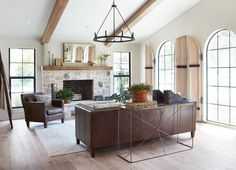 To me, two of the most impactful things in the living and dining room are the floor arched length windows and the vaulted ceilings with wooden beams. By incorporating these two elements into a clean, open space, the whole room instantly feels like a major transformation.