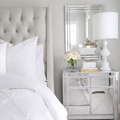 Bedroom inspiration tufted linen bed white bedding bright bedroom mirrored cabinet nightstand white table lamp classic gray wall paint by Benjamin Moore Chantilly lace by Benjamin Moore for trim arhaus bed pintuck white duvet glam bedroom home inspo white and gold decor   (@thedecordiet) on Instagram: