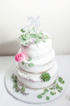 Loved it! Pinned it! A Blooming Envy Design! Cake with Succulents, Pink Ranunculus and Eucalyptus.