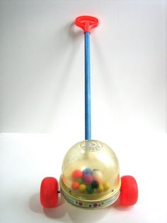 Fisher Price popcorn popper...my Dad cut a hole in the bottom and took out the popping balls on my little brother's :(