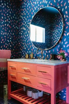 A bold bathroom is achievable for anybody. Even though these rooms are often small, you can still create a playful environment. A fun wallpaper paired with a bright freestanding vanity will outdo any of your previous design fantasies.