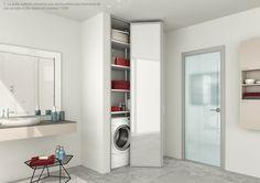 Le porte soffietto chiudono una nicchia attrezzata internamente con un tubo e otto ripiani del sistema I TUBI. By ZEMMA