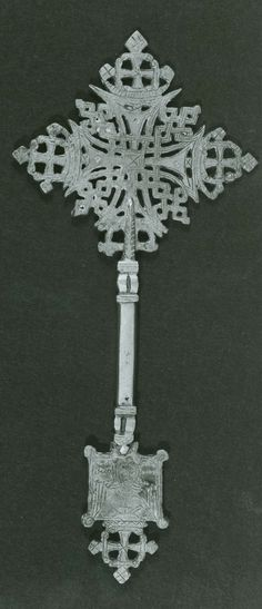 "Ethiopian Hand Cross.  Late 19th Century.  10 5/8 x 4 3/4"".  Yale Accession Number 1977.67.91."