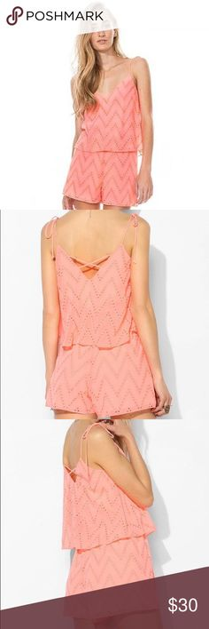 Kavya Double-Layer Eyelet Romper, Peach Silky, airy romper from the trend-setters at DV by Dolce Vita with allover zigzag embroidered eyelet detailing. Trimmed with a breezy top with an open, crisscross back and adjustable ties at the shoulders. Finished with drapey shorts and elastic at the waist. Fully lined. DV by Dolce Vita Dresses Mini