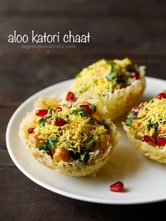 Katori chaat also known as tokri chaat is a popular chaat snack from north India. Fried potato baskets are topped with cooked chana, boiled potatoes, sweet and spicy chutneys, curd and a few spice powders Indian Appetizers, Indian Snacks, Indian Desserts, Appetizer Recipes, Veg Recipes, Indian Food Recipes, Snack Recipes, Cooking Recipes, Cooking Tips