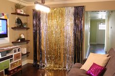 Party backdrop: wrapping paper behind foil fringe. For taking pictures.