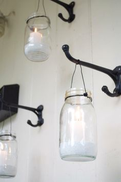 Set a romantic mood with hanging mason jar votive candle holders. Click through to read more about this lovely front porch makeover.