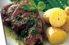 Lamb steaks with mint salsa - Par boil potatoes before baking everything to reduce cooking time, meat was cooked after 20min. Served with balsamic dressed wilted spinach and toasted pine nuts. Yum!