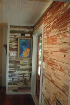 Restored plank wall, hand scraped by owner with intent to re-finish. They fell in love with the patina and let it shine