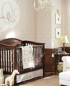 I love this unisex nursery idea from Pottery Barn Kids that features ABC baby crib bedding and an adorable chandelier.