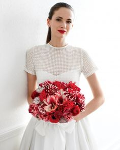 An amazing bouquet of roses, lilies, amaryllis, anemones, ranunculus, and dahlias -- plus, all but the amaryllis are available year-round