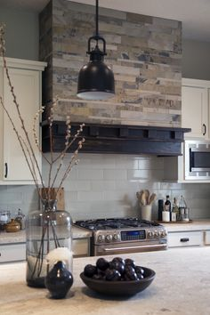 Interior design -ed by Carla Aston, interior designer / Photography by Tori Aston | Home kitchen renovation-remodel-makeover; rustic, coffee house style; stove; backsplash; granite countertop; hood; cabinet.