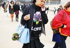 street style: Paris Fashion Week Fall 2014 (Christopher Kane top and Prada bag)...