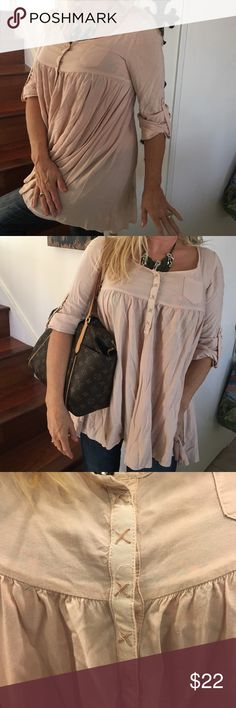 H & M BABY DOLL TOP, PINK Lightest pink baby doll, size 8, snaps up top with embroidered detail. Can be worn long sleeve or three-quarter sleeve with the button. Such a precious top. Color to me looks very light pink or lt peach H&M Tops Blouses
