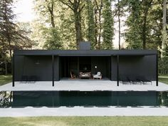 CD Poolhouse is a minimalist holiday home by Belgian designer Marc Merckx, featuring a black timber facade that sits comfortably in it's natural surrounds. Minimalist House Design, Minimalist Home, Outdoor Spaces, Outdoor Living, Tamizo Architects, Modern Pool House, Black Building, Moderne Pools, Pool Houses