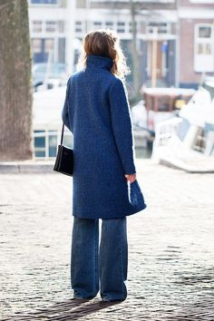 blue textured coat, small bag and flared jeans #style #fashion #winter #denim