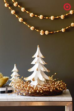 Oh Christmas tree, how lovely are your golden branches. Warm up any nook or table with this metallic decor—there's no such thing as too much gold during the holidays. Plus, it's neutral enough to keep up all winter.