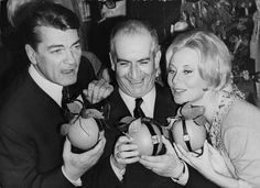 The French actors Jean Marais and Louis de Funes and Michèle Morgan at the presentation of Orange-Film Prize. 24th March 1965. Photograph.