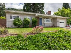 Adorable West Side ranch home with mountain, valley and mature tree views is attractively updated to meet today's busy lifestyle. Hardwood floors throughout the living areas and bedrooms and tile flooring in the updated kitchen allow for easy clean-up.
