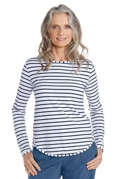 "Turn heads with this relaxed fit sun protective top in rich stripped colors designed for travel or everyday wear. With a ""hits at the hip length"" this Side Split Shirt is comfortable and sporty right down to the scoop neckline. Nothing beats comfortable lightweight shirts to wear that include the added benefit of UPF 50+ sun protection for those harmful rays you just don't need.  Side Split Shirt: Sun Protective Clothing - Coolibar"