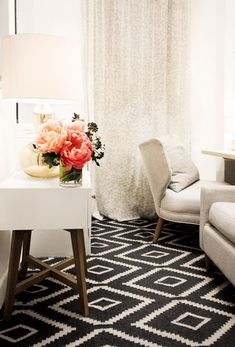 Gorgeous diamond-print black and white rug and sleek white furniture