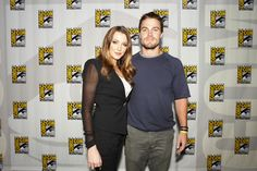 "ARROW stars Katie Cassidy and Stephen Amell give a look at Comic-Con 2012 that surely says, ""With this show, you are in for a thrill ride."" We believe it! (© WBEI. All Rights Reserved.)"