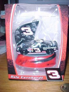 2008 Dale Earnhardt #3 Car NASCAR Collectible Ornament by NASCAR. $12.95. This a very detailed ornament of Dale Earnhardt's #3 Goodwrench car on a red platform.  It would make a nice gift for any NASCAR fan especially if a Dale Earnhardt #3 fan.  #EarnhardtMemorabilia